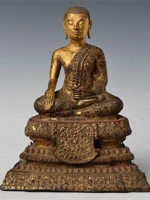 Discepolo tailandese seduto, in bronzo dorato